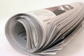 Devine in newspaper