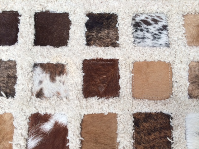 How do you clean a Cowhide Rug?